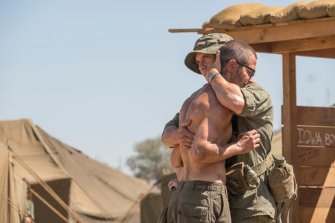 Brothers Nicky (Michael Angarano), on the left, and Jack Pearson (Milo Ventimiglia) embrace while they served in the army during the Vietnam War.