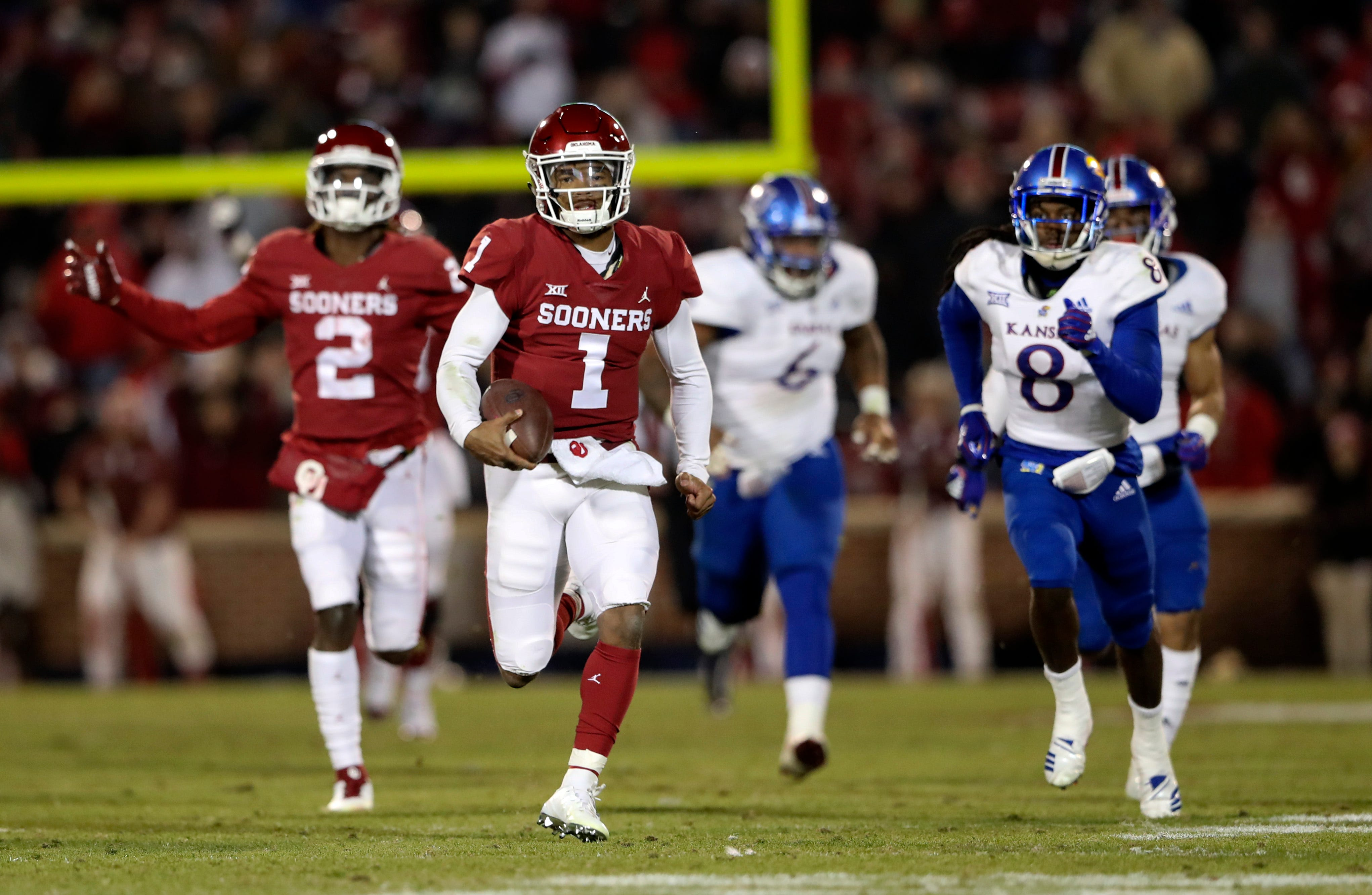 OKlahoma quarterback Kyler Murray breaks free for a touchdown during the second half against Kansas.