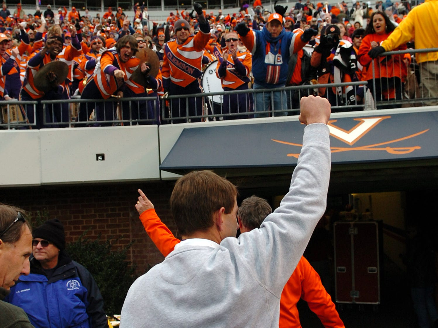 Clemson interim head coach Dabo Swinney gives a fist pump to the Tiger fans as he leaves the field after the Tigers 13-3 win over Virginia Saturday, November 22, 2008 at UVA's Scott Stadium in Charlottesville, Va.