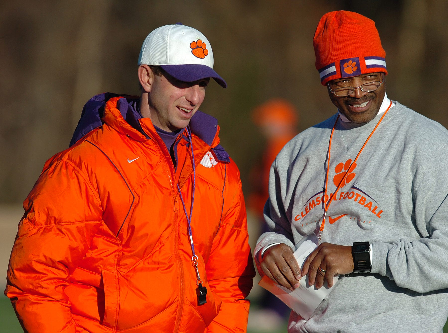 Clemson interim head coach Dabo Swinney talks with new defensive backs coach Charlie Harbison during practice Friday, December 12, 2008 at the teams practice field.