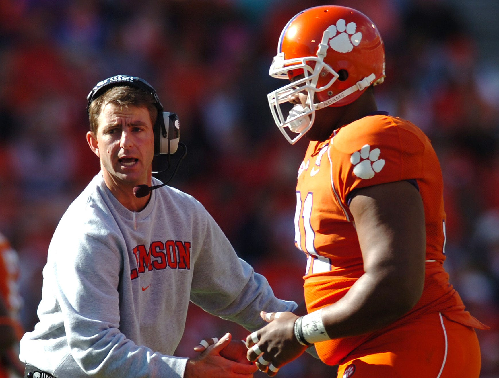 Clemson interim head coach Dabo Swinney congratulates Rashaad Jackson (91) after the defense stopped Duke during the 2nd quarter  Saturday, November 15, 2008 at Clemson's Memorial Stadium in Clemson, SC.