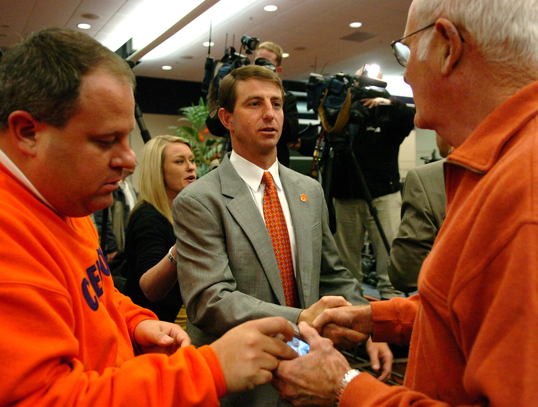 Dabo Swinney is congratulated by fans after he was announced as Clemson's head football coach during a press conference at Memorial Stadium in Clemson Monday, December 1,  2008.