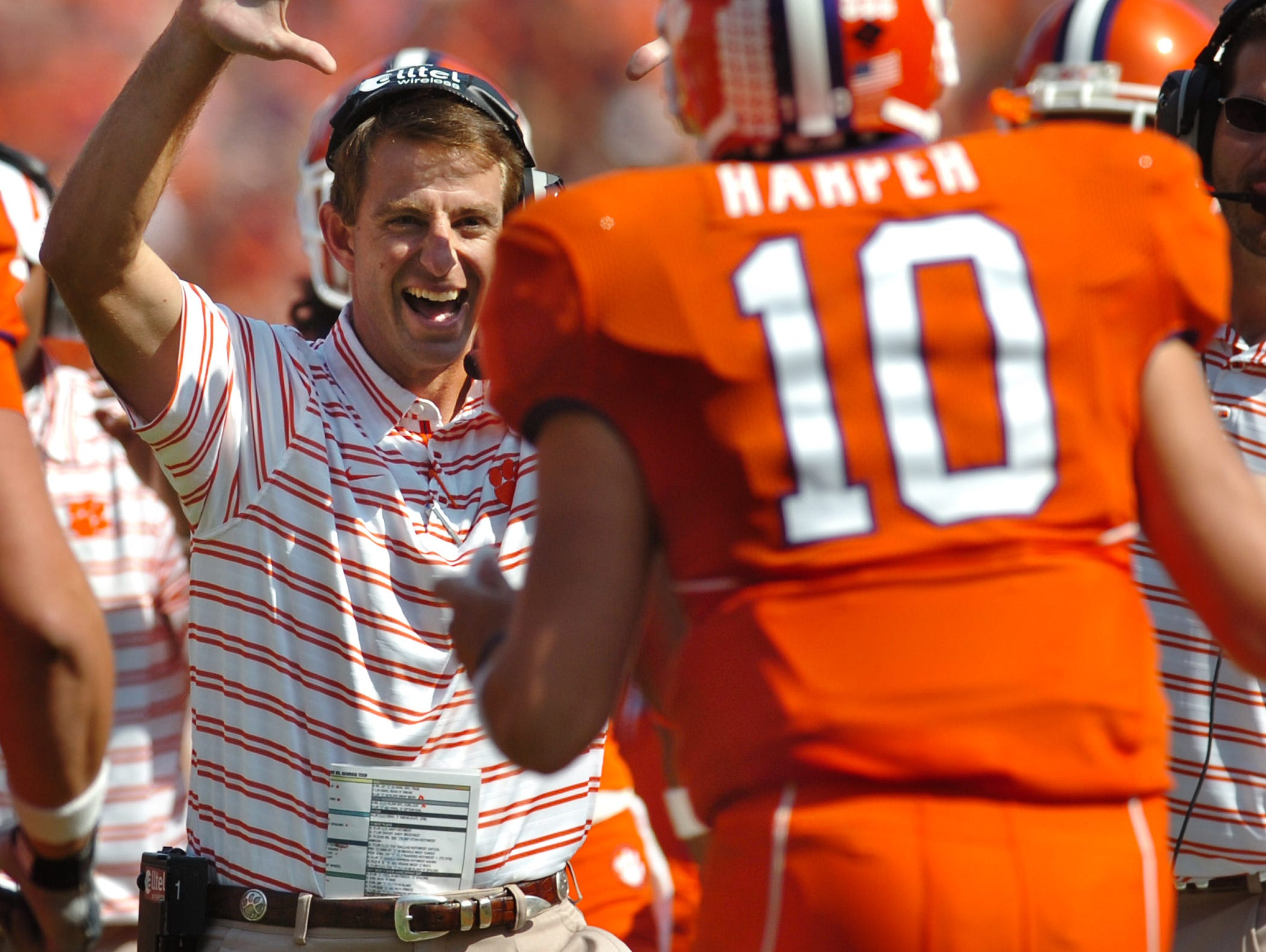 Clemson's  interim head Coach Dabo Swinney  celebrates with QB quarterback Cullen Harper (10) after Harper threw a 32 yard TD pass to Aaron Kelly (80) during the 3rd quarter against Georgia Tech Saturday, Oct. 18, 2008 at Clemson's Memorial Stadium.