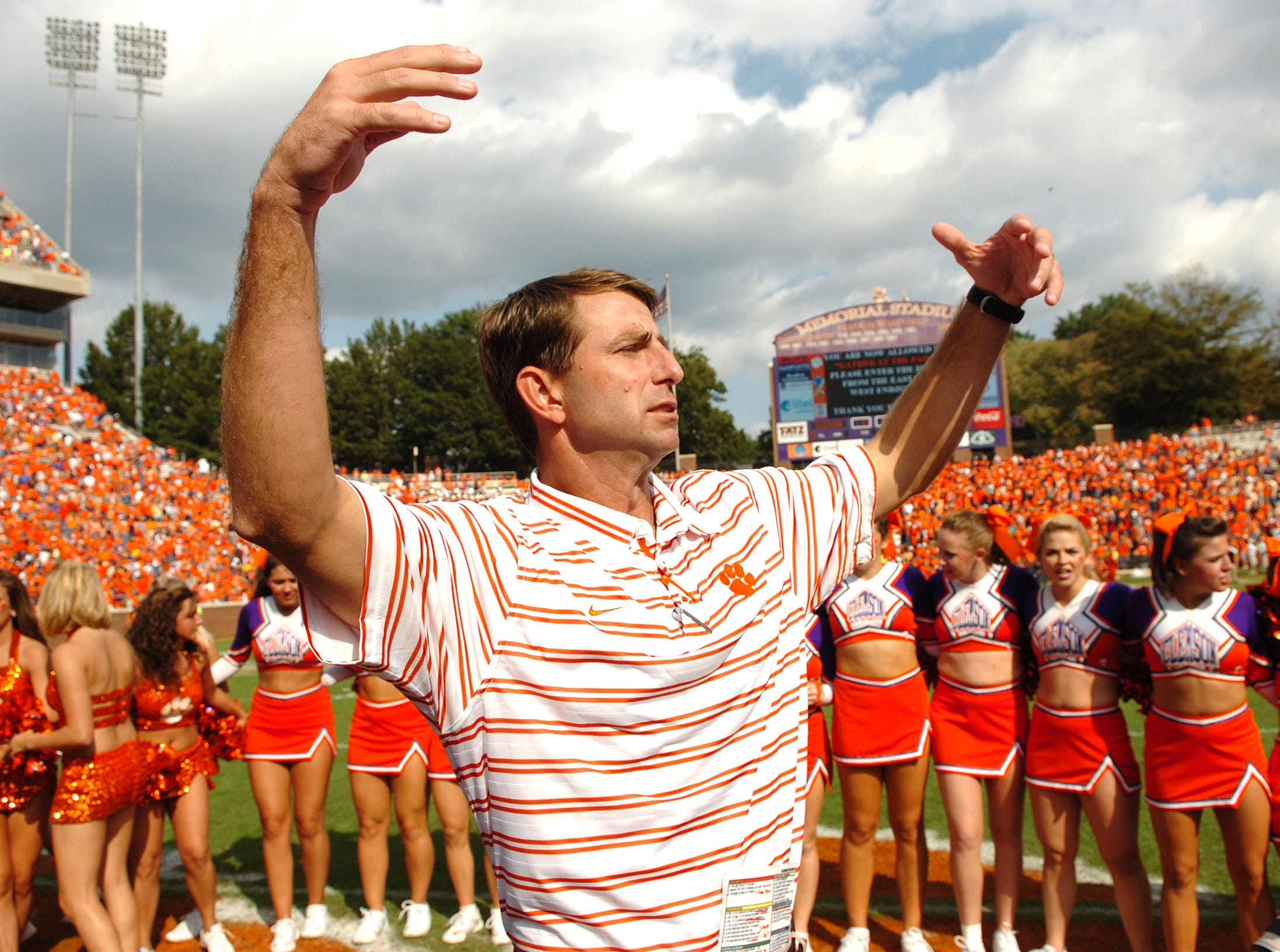 Clemson's  interim head Coach Dabo Swinney gathers his team at center field as the band plays the school's alma mater after the Tigers 21-17 loss to Georgia Tech Saturday, Oct. 18, 2008 at Clemson's Memorial Stadium.