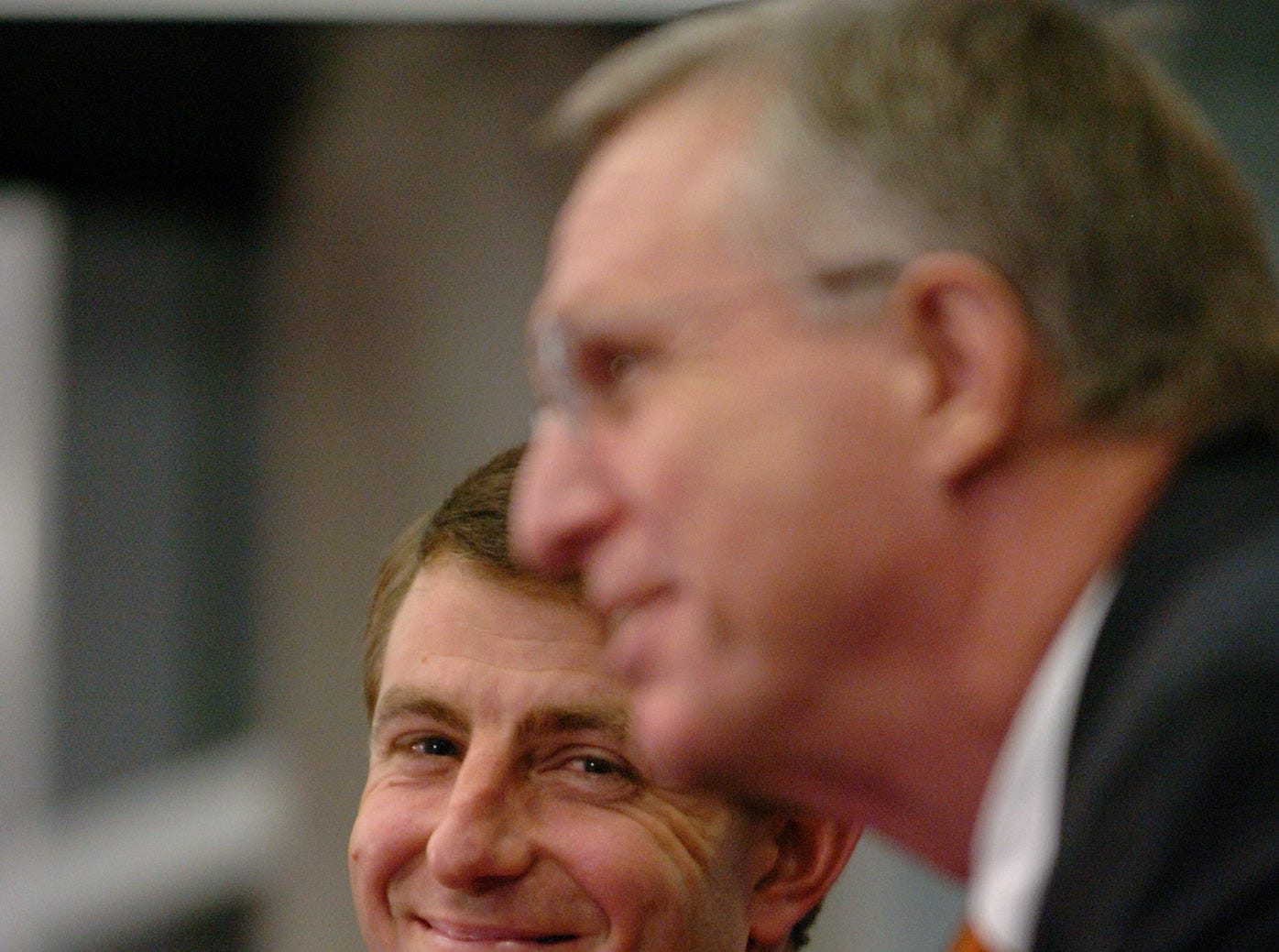 Dabo Swinney listens as Terry Don Phillips speaks during a press conference where Swinney was announced as Clemson's head football at Memorial Stadium in Clemson Monday, December 1,  2008.