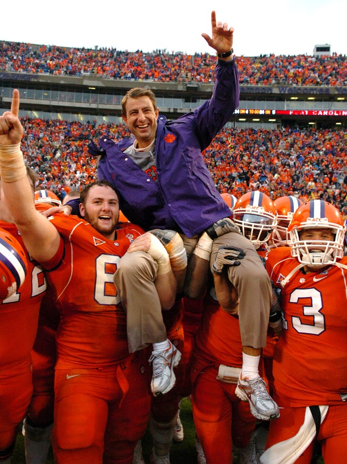 Clemson interim head coach Dabo Swinney is carried off the field by Thomas Austin (65), left, and Tyler Grisham (13) after the Tigers 31-14 win over South Carolina Saturday, November 29, 2008 at Clemson's Memorial Stadium.