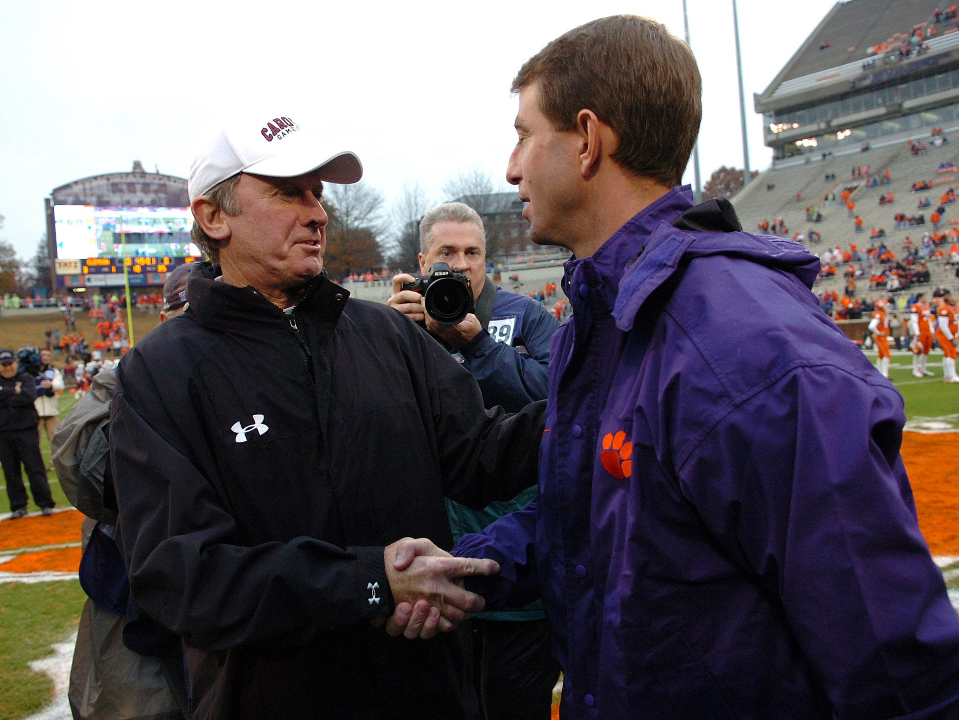 Clemson interim head coach Dabo Swinney, right, shakes hands with South Carolina head coach Steve Spurrier before the start of their game Saturday, November 29, 2008 at Clemson's Memorial Stadium.