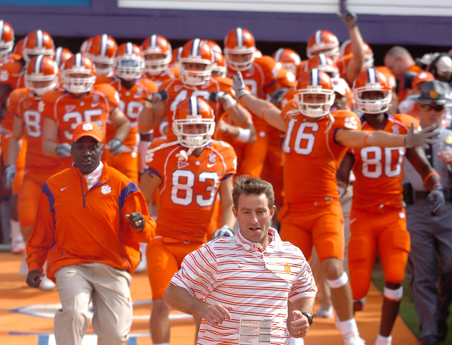 Clemson's  interim head Coach Dabo Swinney leads the Tigers down the hill before their game against Georgia Tech Saturday, Oct. 18, 2008 at Clemson's Memorial Stadium.