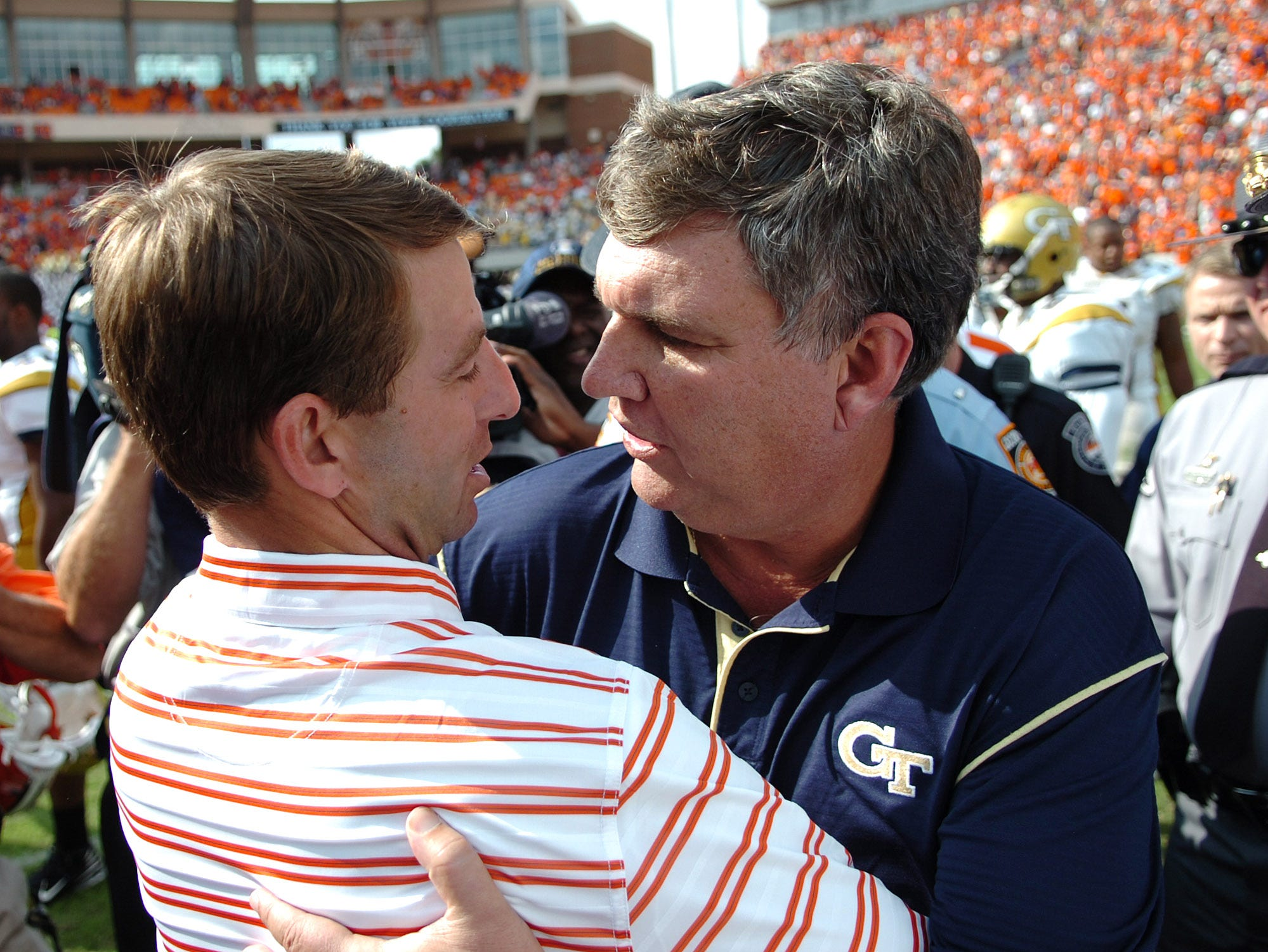 Clemson's  interim head Coach Dabo Swinney meets with Georgia Tech head coach Paul Johnson after the Tigers 21-17 loss Saturday, Oct. 18, 2008 at Clemson's Memorial Stadium.
