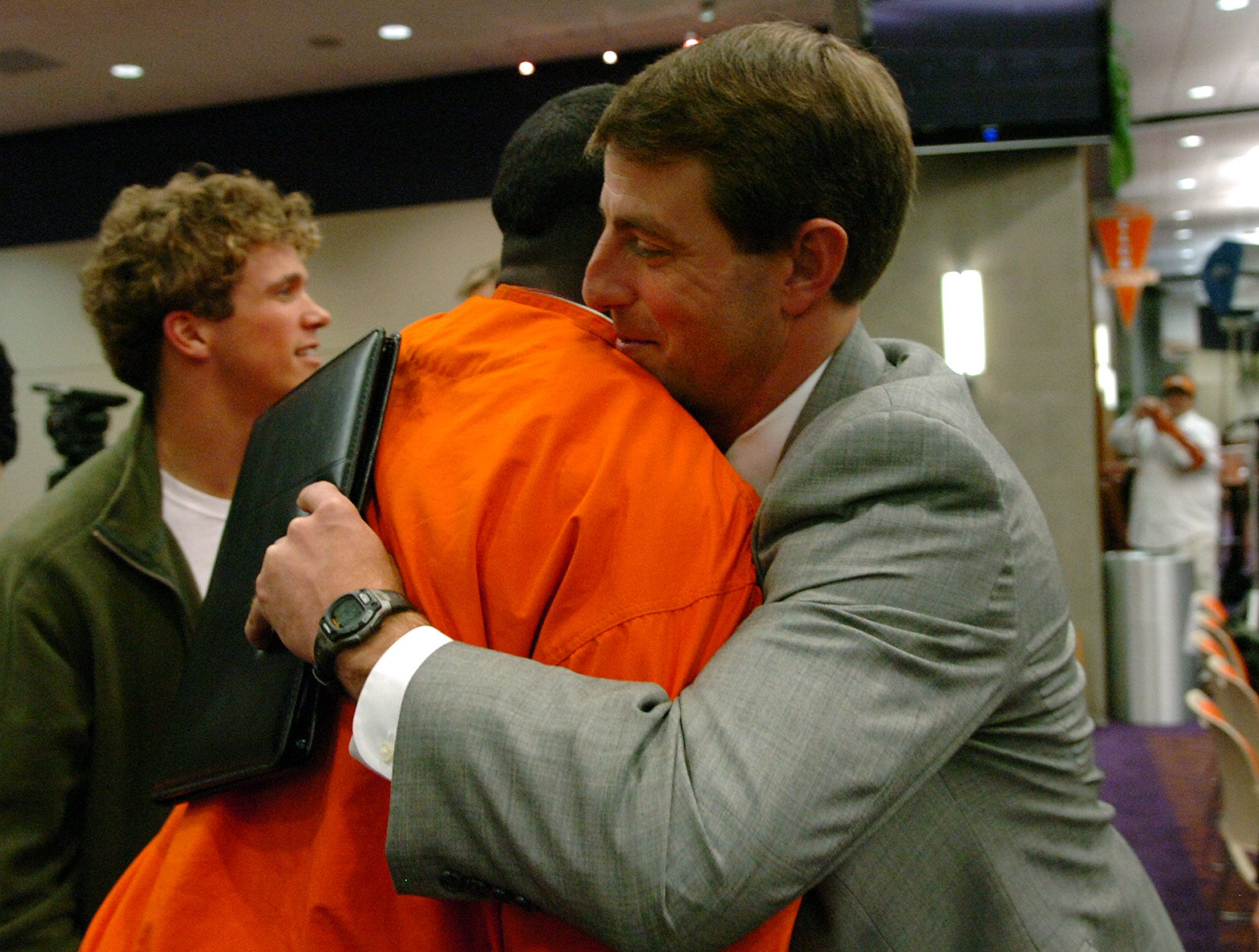 Dabo Swinney hugs running back James Davis after a press conference at Memorial Stadium in Clemson Monday, December 1,  2008 where Swinney was named Clemson's head football coach during a press conference