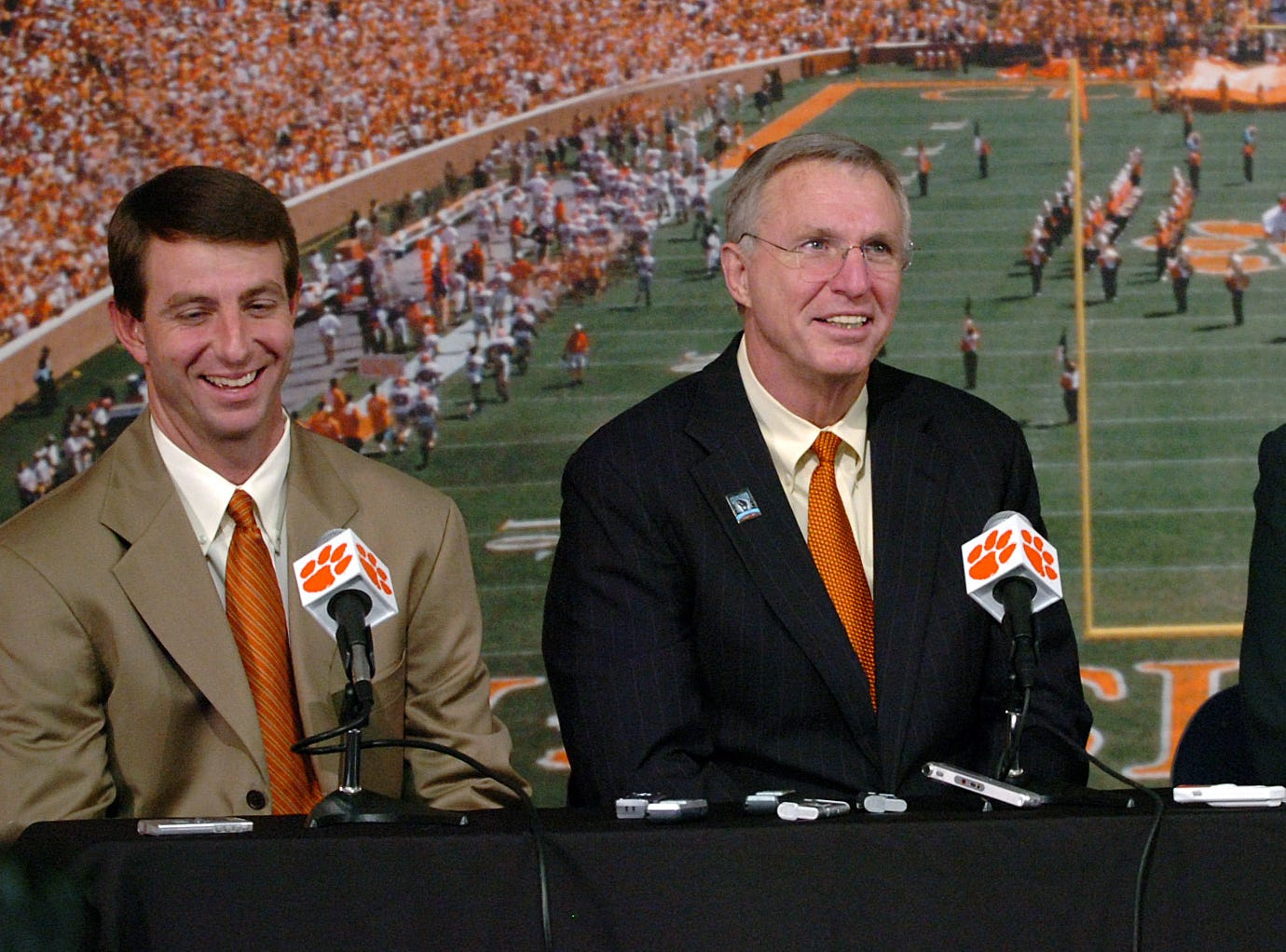 Clemson head coach Dabo Swinney, left, and Athletic Director Terry Don Phillips accept an invitation from Gator Bowl Selection Chair Kelly Madden to play in the 2009 Gator Bowl during a press conference in Clemson Wednesday, December 3,  2008.