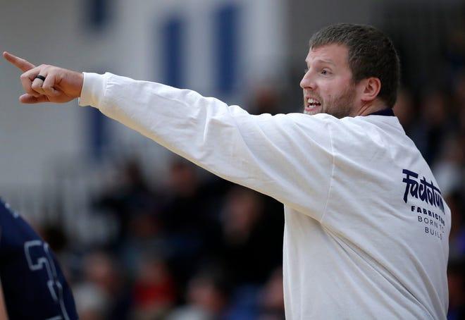 Appleton North boys basketball coach Chris Kellett directs his team during their game against Xavier earlier this season.