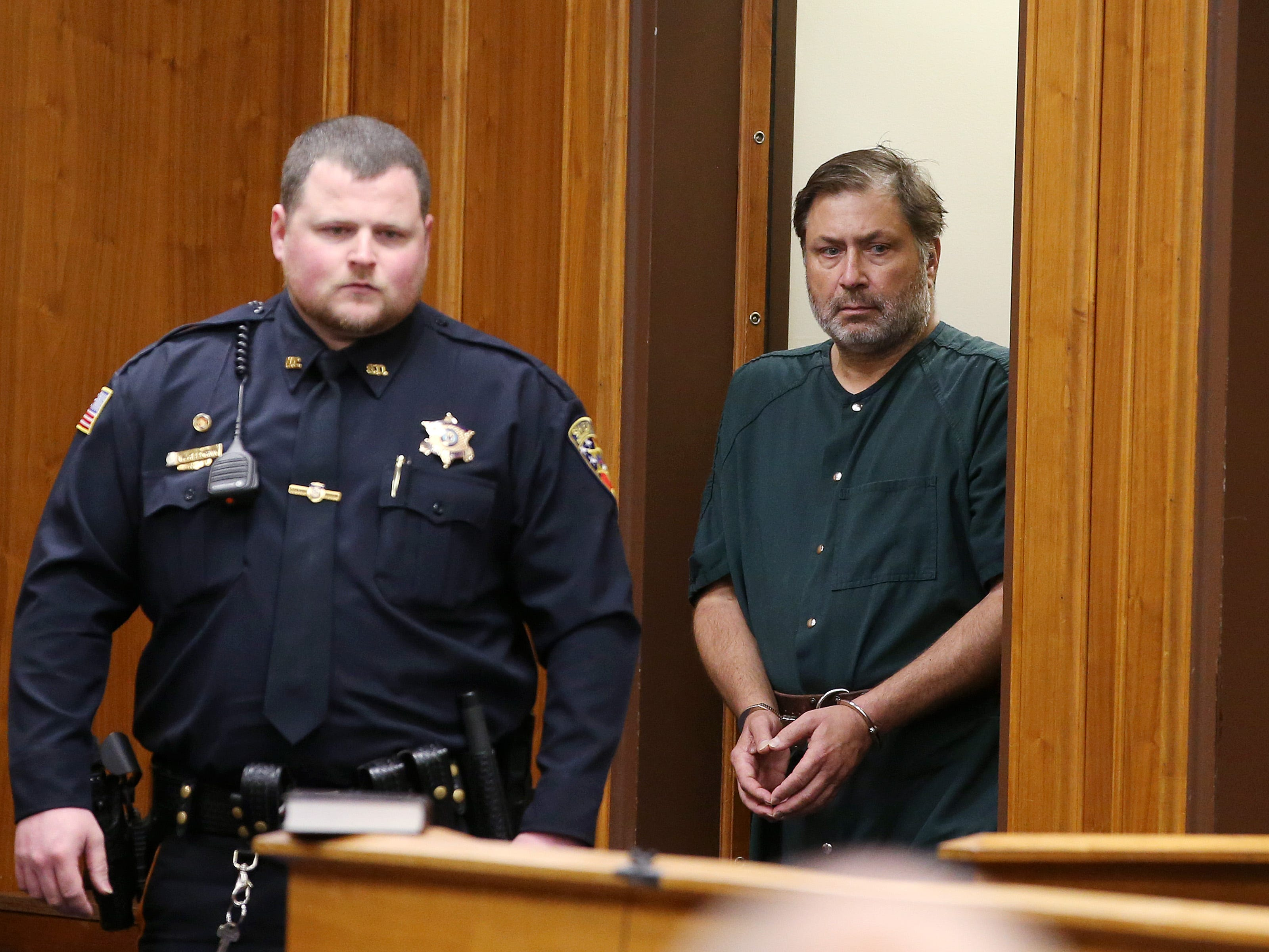 Paul Caneiro, who is charged with the murder of his brother, his brother's wife and two children and setting an arson fire to their Colts Neck home and his own home in Ocean Twp., appears for his first appearance and detention hearing before Judge James McGann at the Monmouth County Courthouse in Freehold, NJ Friday November 30, 2018.
