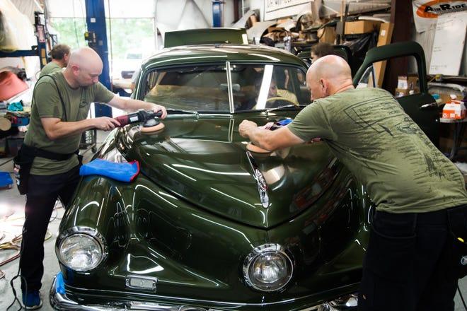 Bob and Doug Cunningham polishing a Tucker for Finer Details, Long Branch.