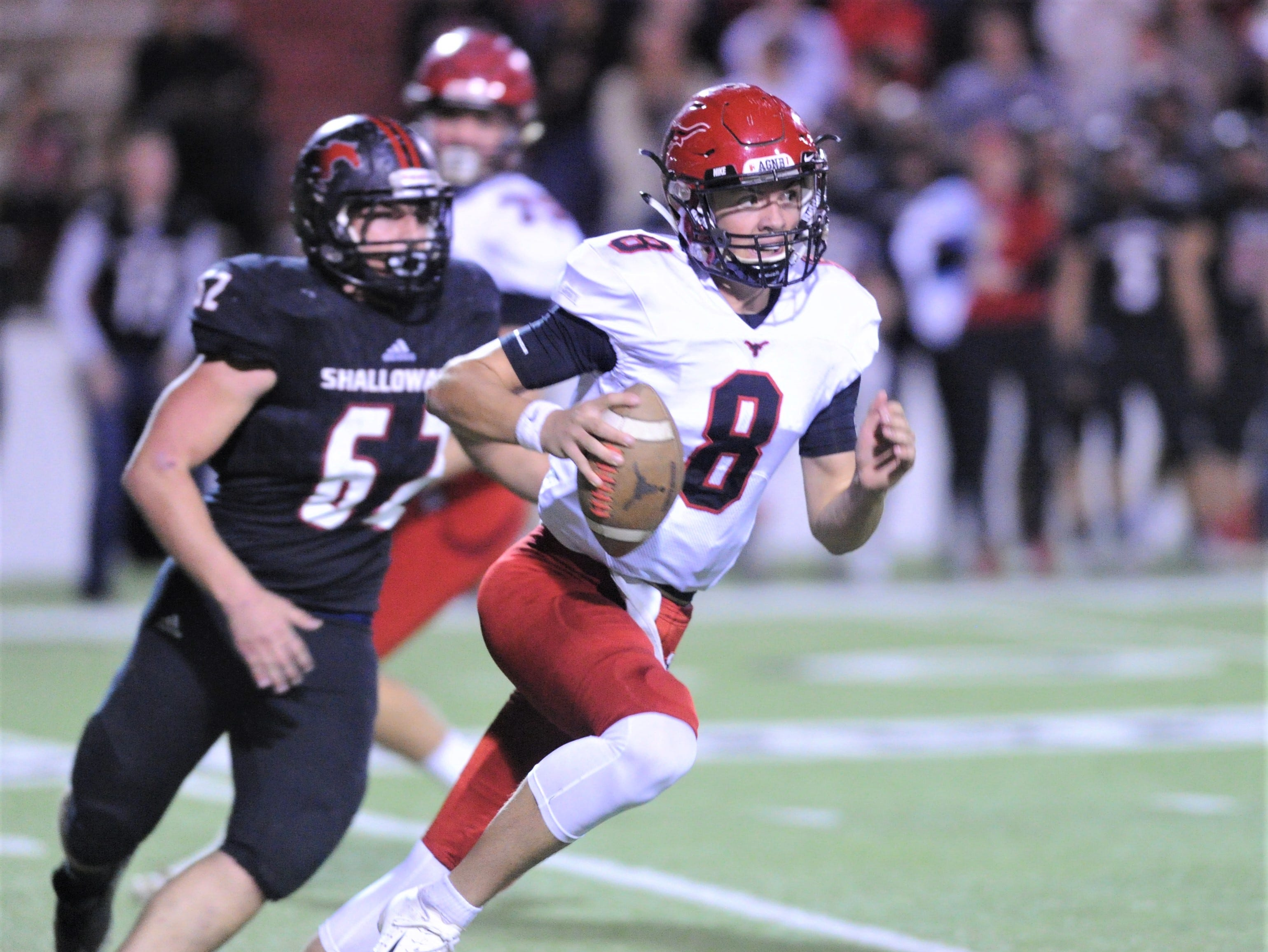 Eastland quarterback Behren Morton (8)  runs with the ball as Shallowater's Ryan Eller gives chase. Shallowater beat the Mavericks 56-21 in the Region I-3A Division I semifinal playoff game Thursday, Nov. 29, 2018, at the Mustang Bowl in Sweetwater.