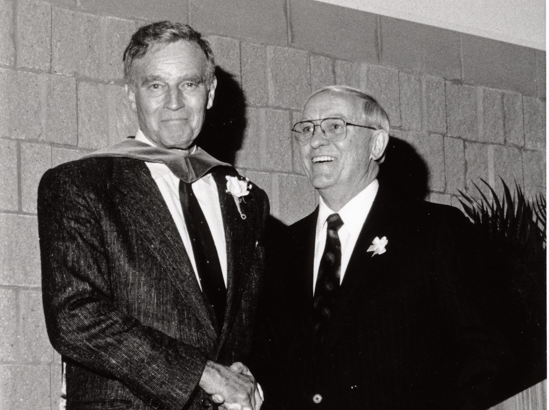Dr. William J. Teague, right, with Charleton Heston at the 1991 President's Circle dinner.