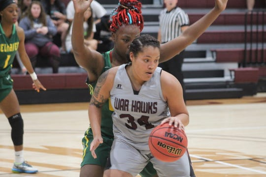 Skyler Reyna (34) makes a move in the post during McMurry's 77-74 victory over Belhaven Thursday Nov. 29, 2018.