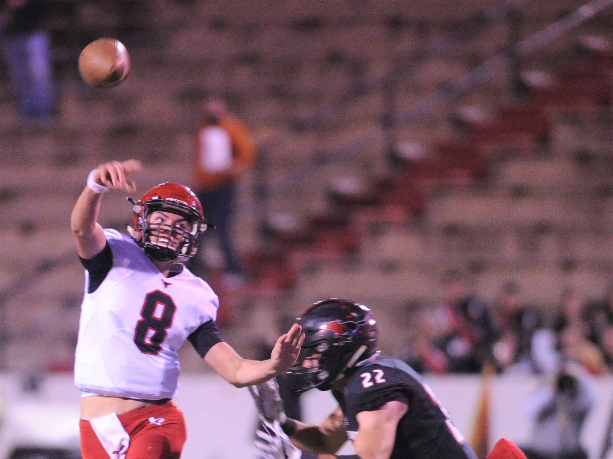 Eastland quarterback Behren Morton, left, throws a pass as Shallowater's Hayden Vanderroest applies pressure. Shallowater beat the Mavericks in the Region I-3A Division I semifinal playoff game Thursday, Nov. 29, 2018, at the Mustang Bowl in Sweetwater.