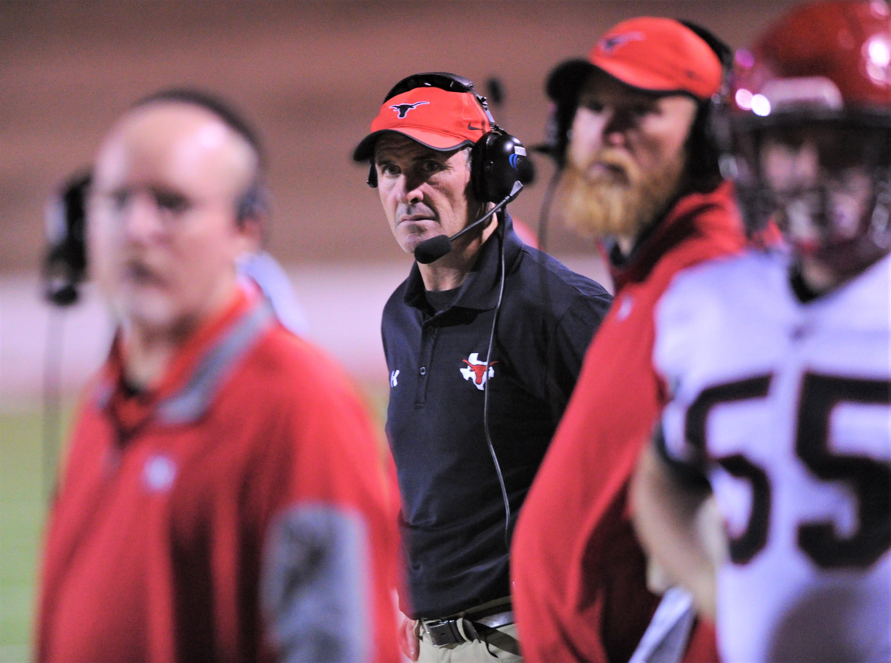 Eastland coach James Morton , center, watches his team play against Shallowater in the the fourth quarter. Shallowater beat the Mavericks 56-21 in the Region I-3A Division I semifinal playoff game Thursday, Nov. 29, 2018, at the Mustang Bowl in Sweetwater.