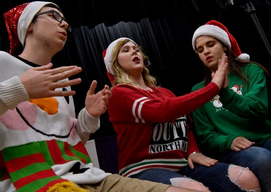 Junior Alex Withers and seniors Breanna Bruneau and Kaylee Hervey perform with the rest of the Wylie High School show choir VocalPoint during Thursday's Bulldog Christmas Market at Wylie High School.