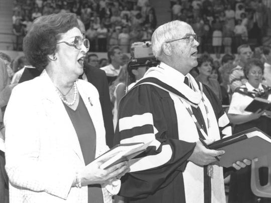 Peggy and William J. Teague sing in Moody Coliseum on the Abilene Christian University.