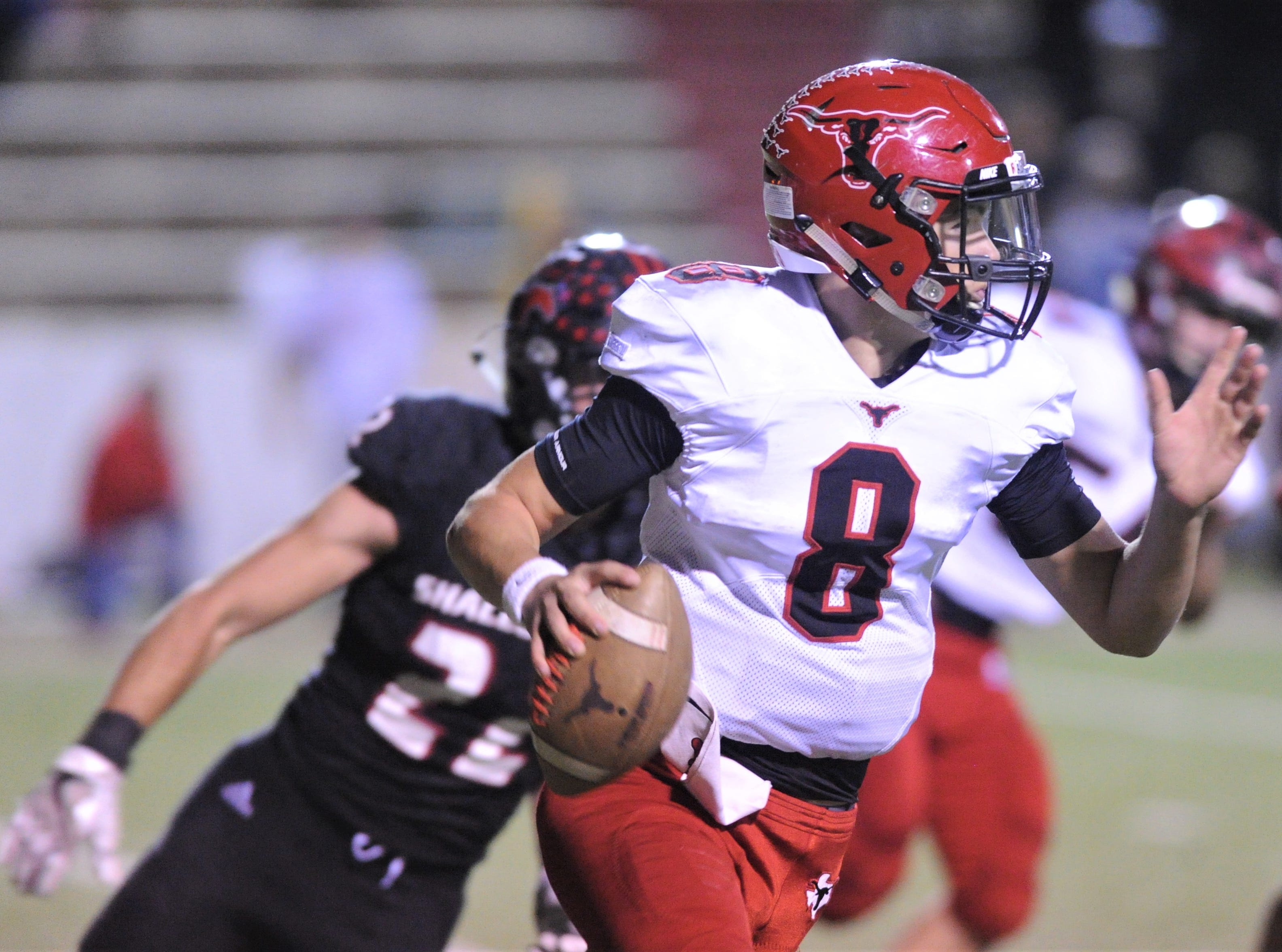 Eastland quarterback Behren Morton (8) scrambles while a Shallowater defender chases him. Shallowater beat the Mavericks 56-21 in the Region I-3A Division I semifinal playoff game Thursday, Nov. 29, 2018, at the Mustang Bowl in Sweetwater.