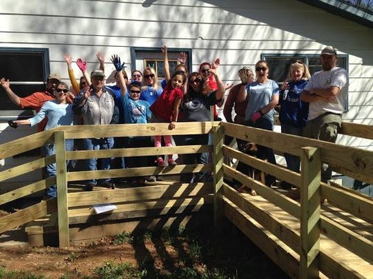 A group of volunteers working on a project with the Community Housing Coalition of Madison County.