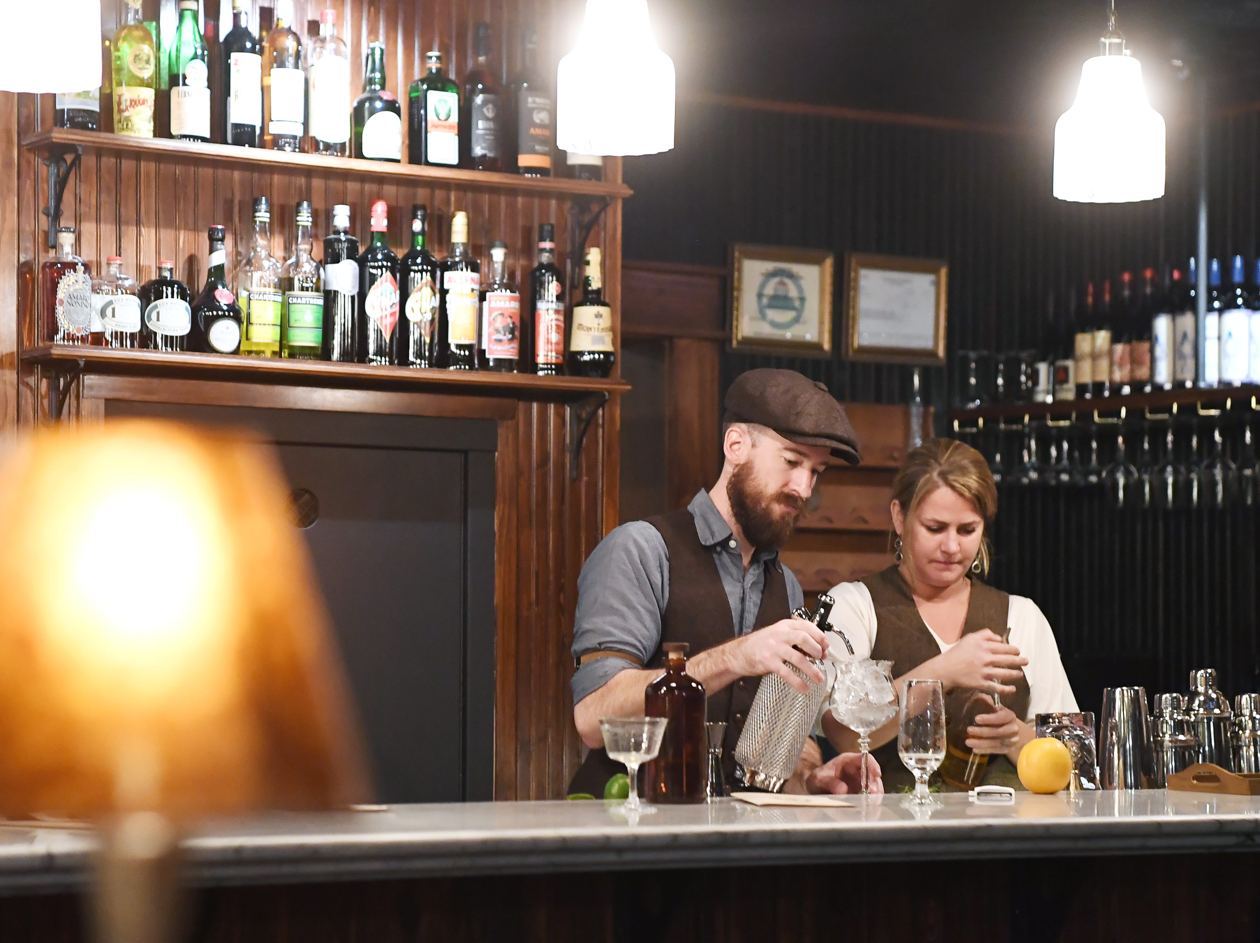 Antidote's general manager, Jonny Burritt, and bar manager Andrea Seng mix cocktails Nov. 28, 2018.