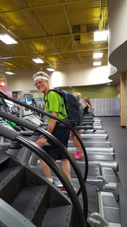 Bob DeBrecht of Asheville trained for his South Beyond 6,000 Hiking Challenge by carrying 30 pounds of kitty litter on his back on the treadmill.