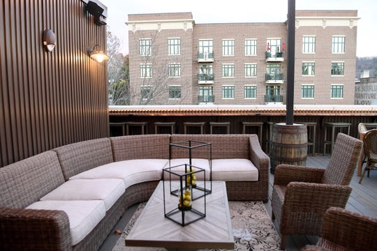 The Antidote cocktail bar is set in a new, three-story building with a rooftop and front patio.