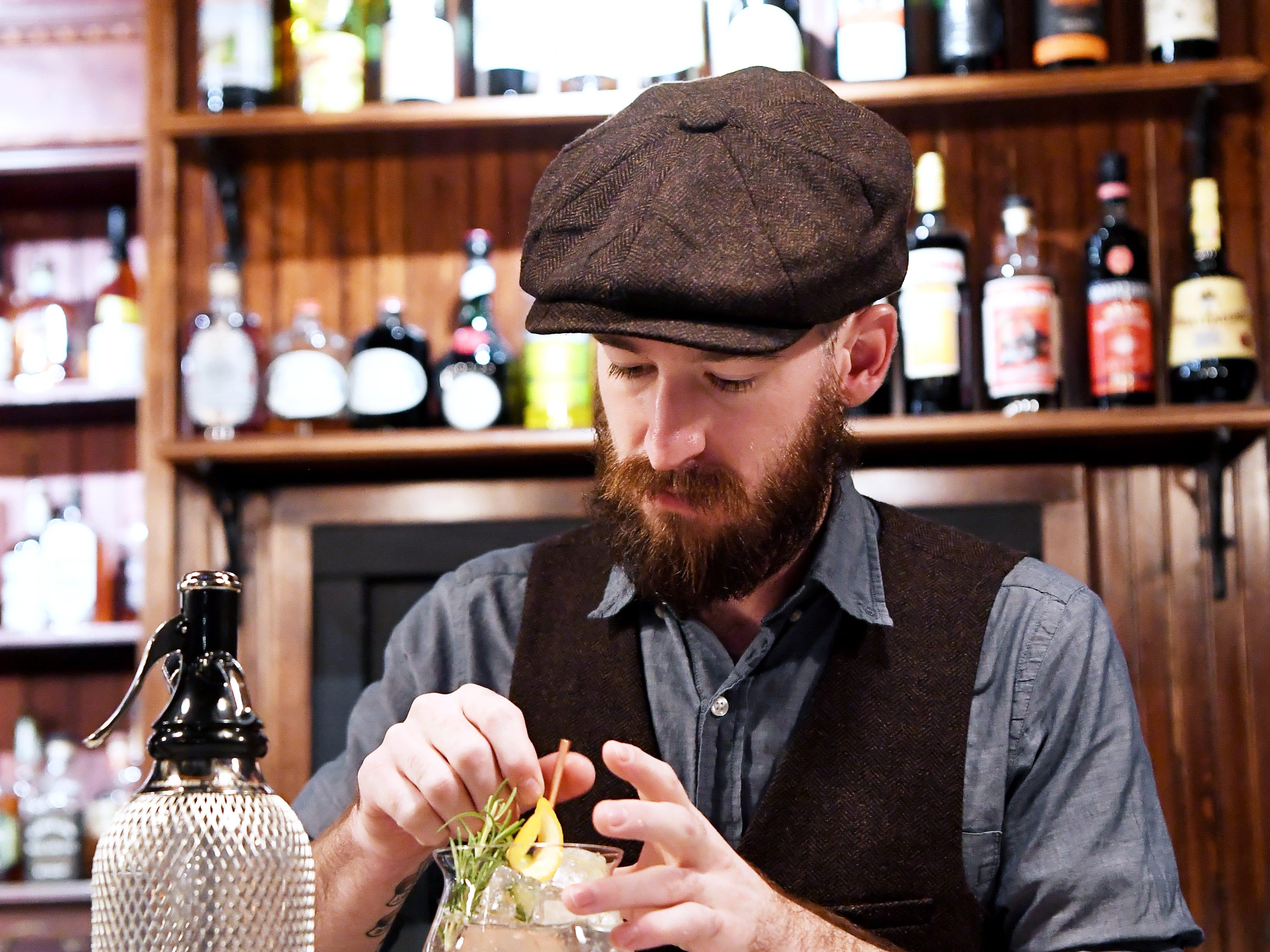 "Antidote's general manager, Jonny Burritt, mixes an Irish ""gin tonic"" Nov. 28, 2018."