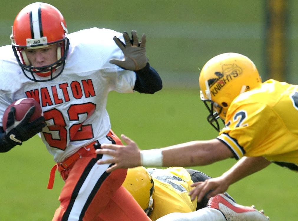 From 2001: Walton's James Armstrong avoids the stretched out arms of Windsor's Scott Knickerbocker in the first quarter Saturday afternoon in Windsor.