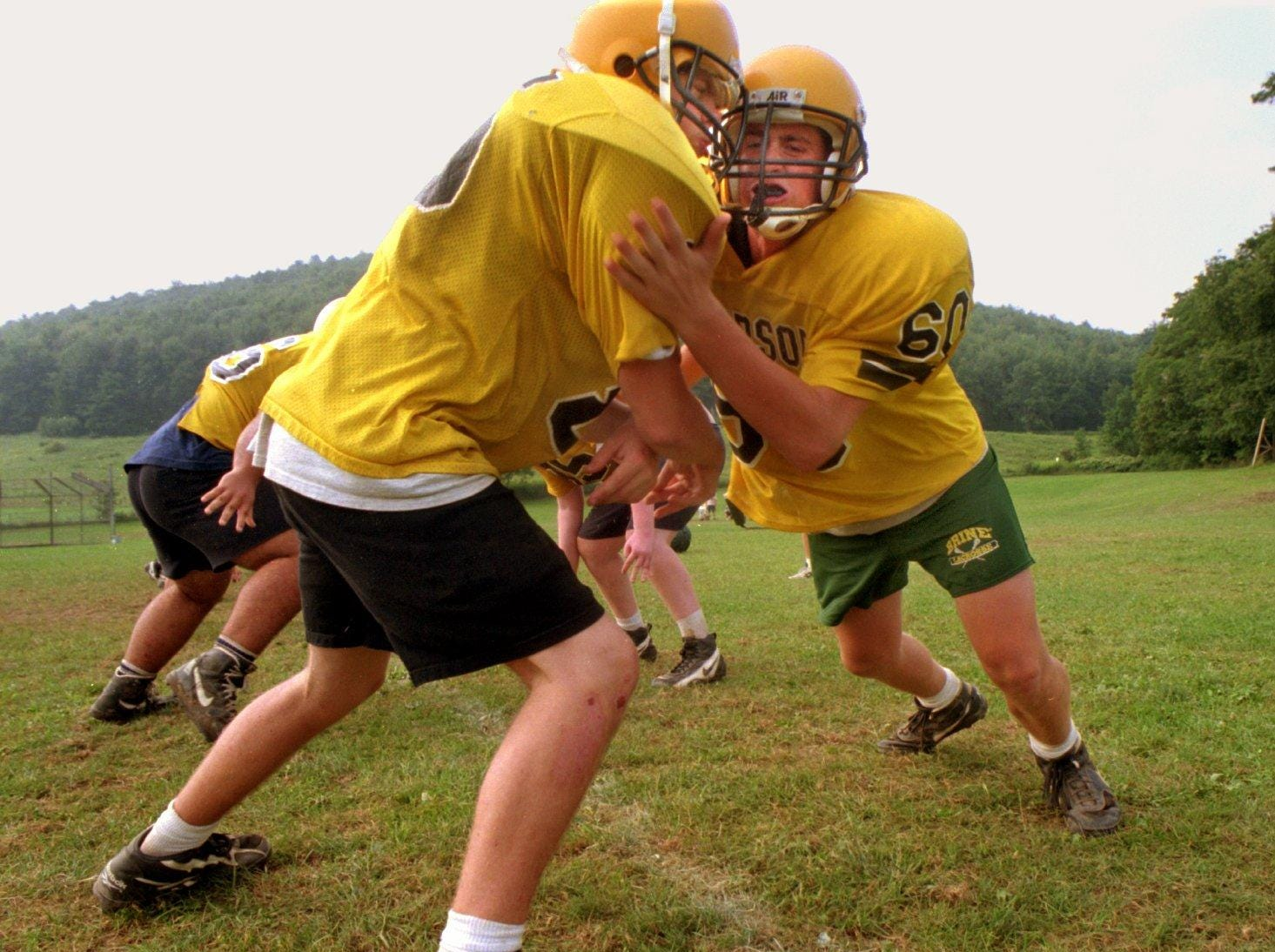 From 1996: Windsor High School football linemen John Connelly, right, and John Oswald, left, practice a defensive line drill.