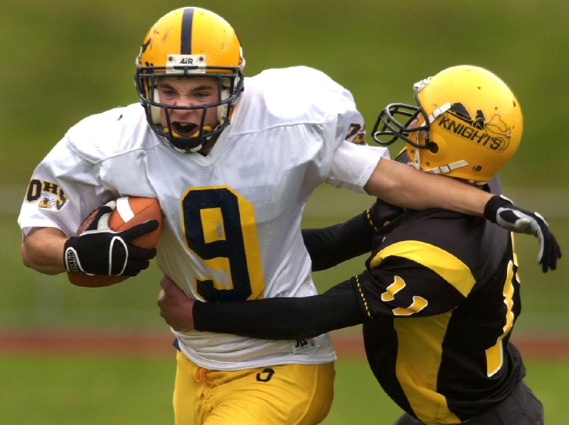 From 2001: -  -Oneonta's Mike Konstanty is grabbed from behind by Windsor's Ryan Riley, but was able to break the tackle ann again more yardage in the second quarter in Windsor Saturday afternoon.