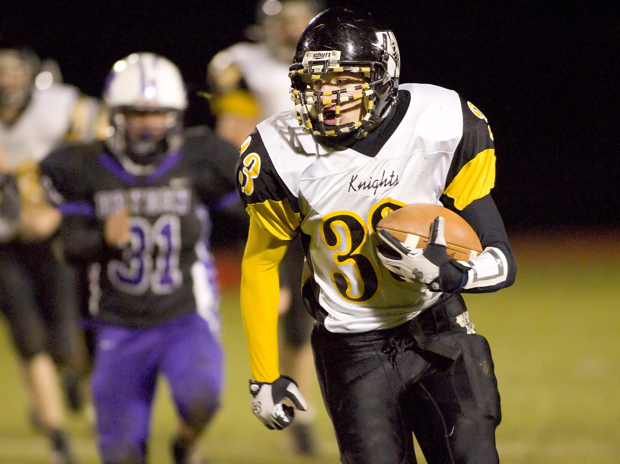 From 2008: Windsor's Josh Quinn rushes the ball upfield as Dryden's Willy Enslow trails Saturday at Dryden High School.