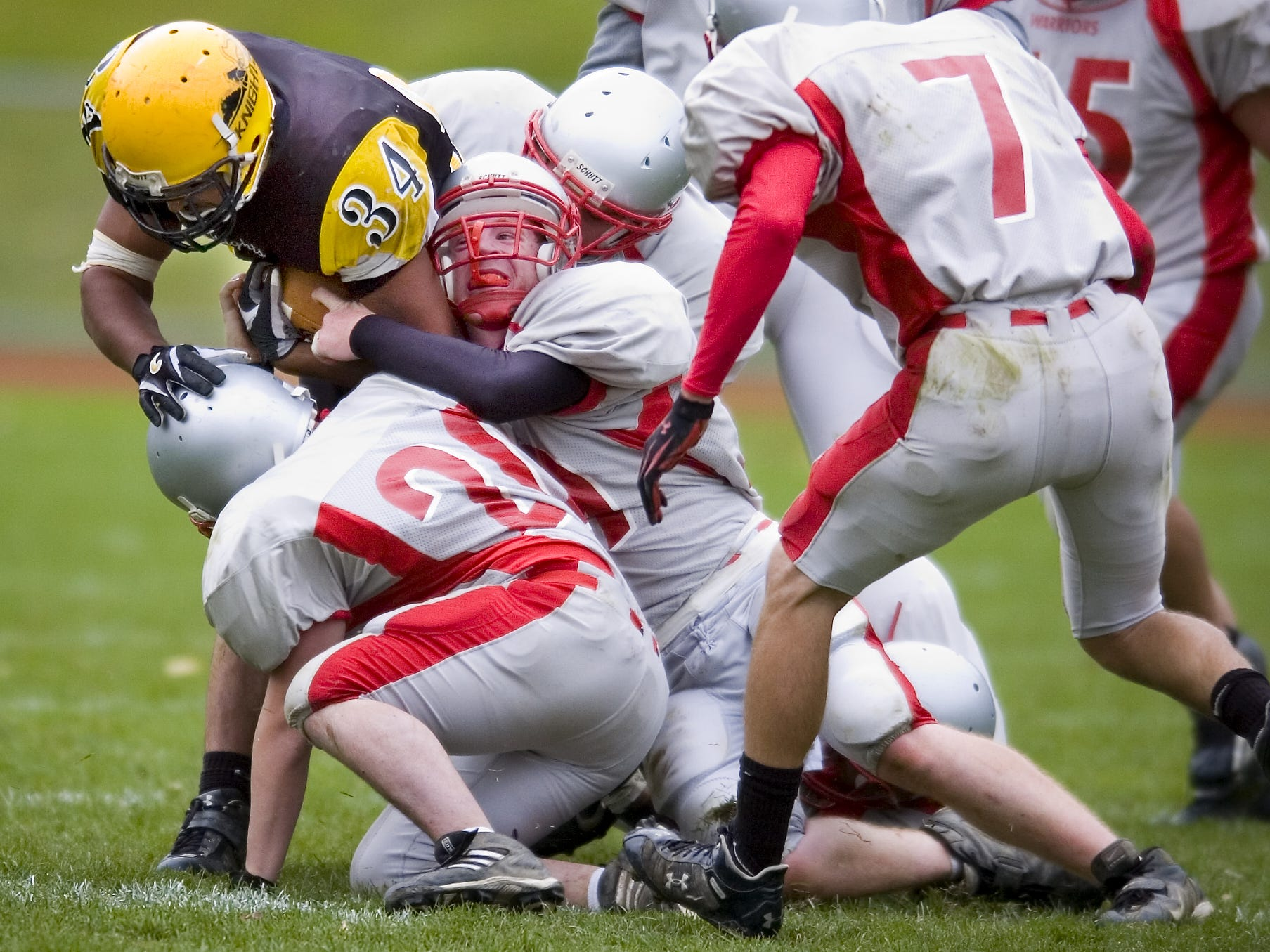 From 2006: Windsor's Bryant Parker is pulled down by a trio of Chenango Valley players during the game  Saturday. Windsor won 15-14.