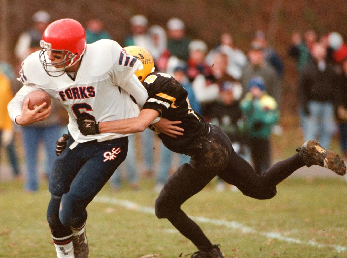 From 1996: Chenango Forks quarterback Rob Markert is taken down by Windsor's Andy Bartholomew in the second quarter of Saturday's Section IV Class B football semi-final game at Windsor.