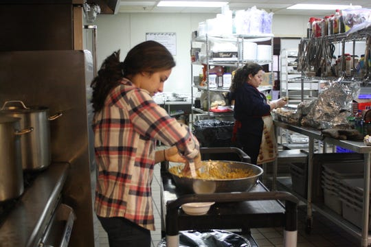 Isabelle Sehati, a 20-year-old senior political science major at Binghamton University, prepares matzah balls in the kitchen of the Rohr Chabad Center for Jewish Student Life in Vestal on Nov. 30.