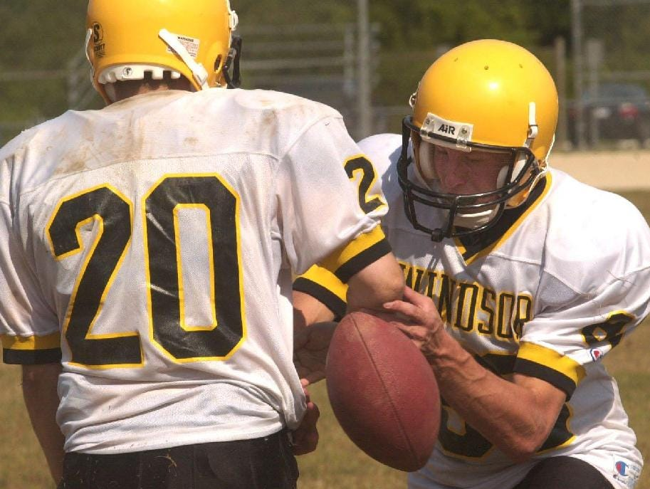 From 2001-  -Windsor's Gabe Tennant, 20, and Matt Denny, 80, work on stripping the football away practice drill.