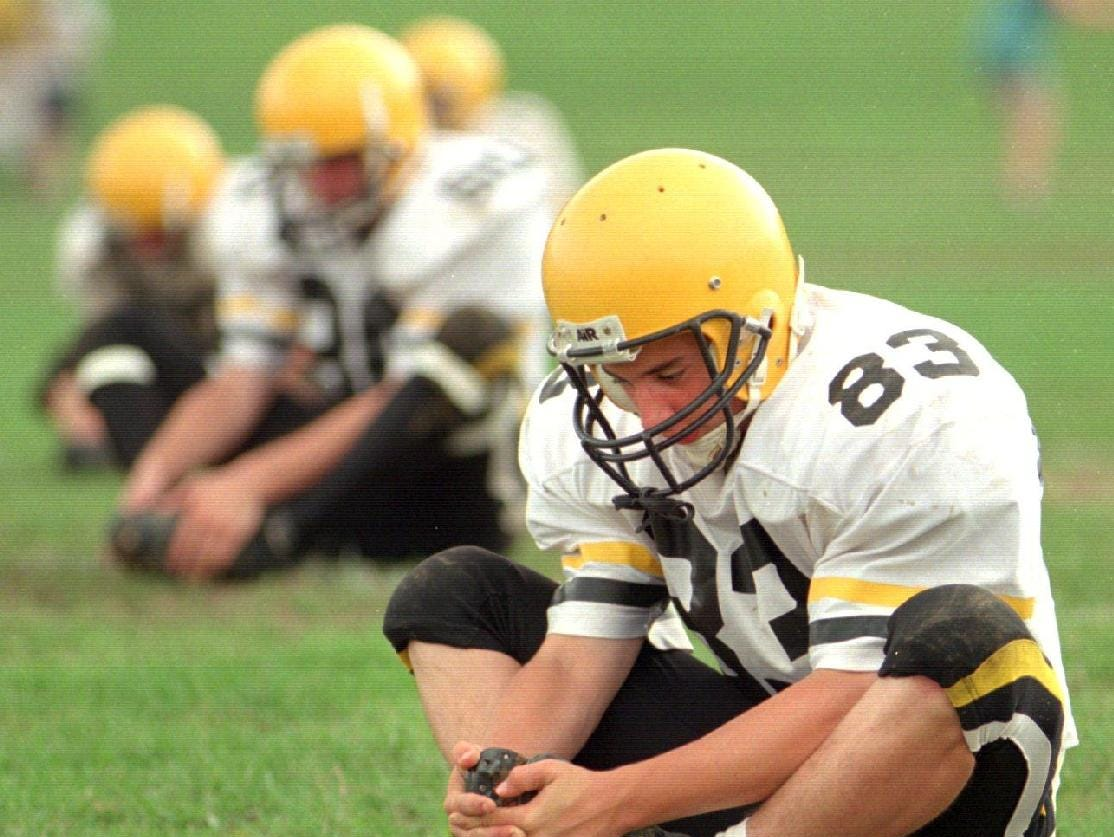 From 1997: Chris Fox and his teammates stretch out at the beginning of varsity football practice at Windsor high school.