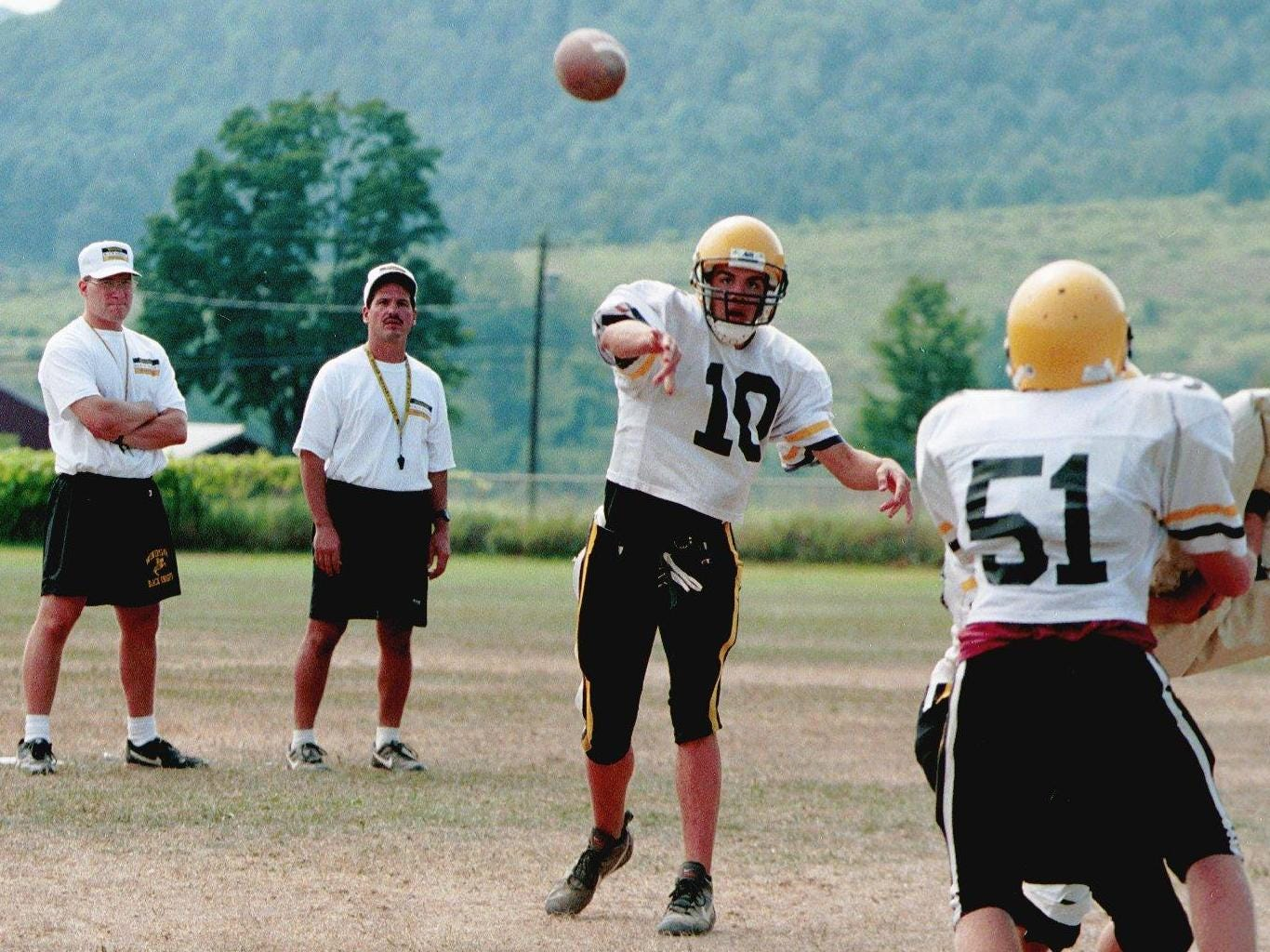 From 1998: Windsor varsity football coaches Bill Zakrajsek (left) and Jerry Testa (right) watch Windsor quarterback  throw a pass during a practice.
