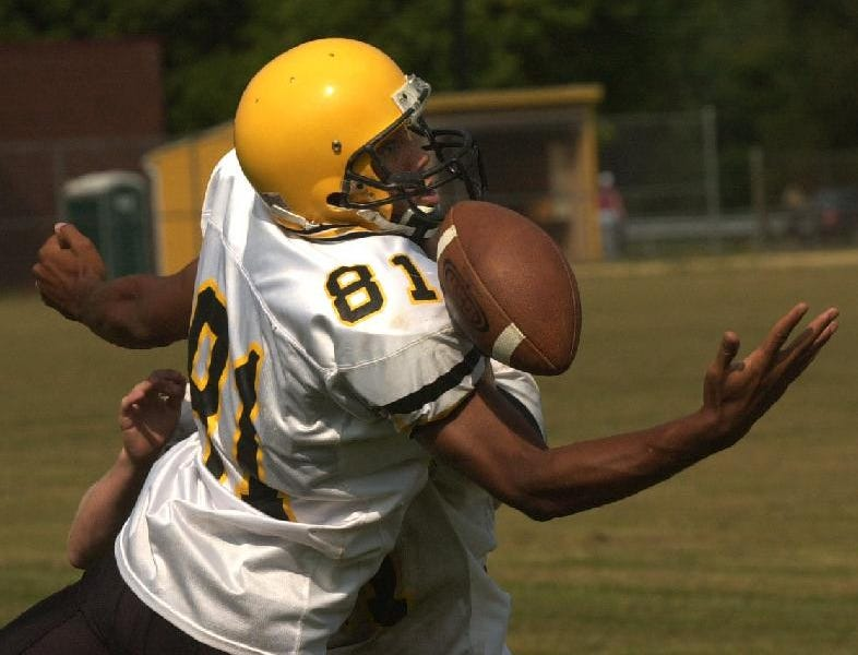 From 2003: Windsor offensive end/defensive back Mike Garror breaks up a pass to teammate Tim Gow during practice last week.