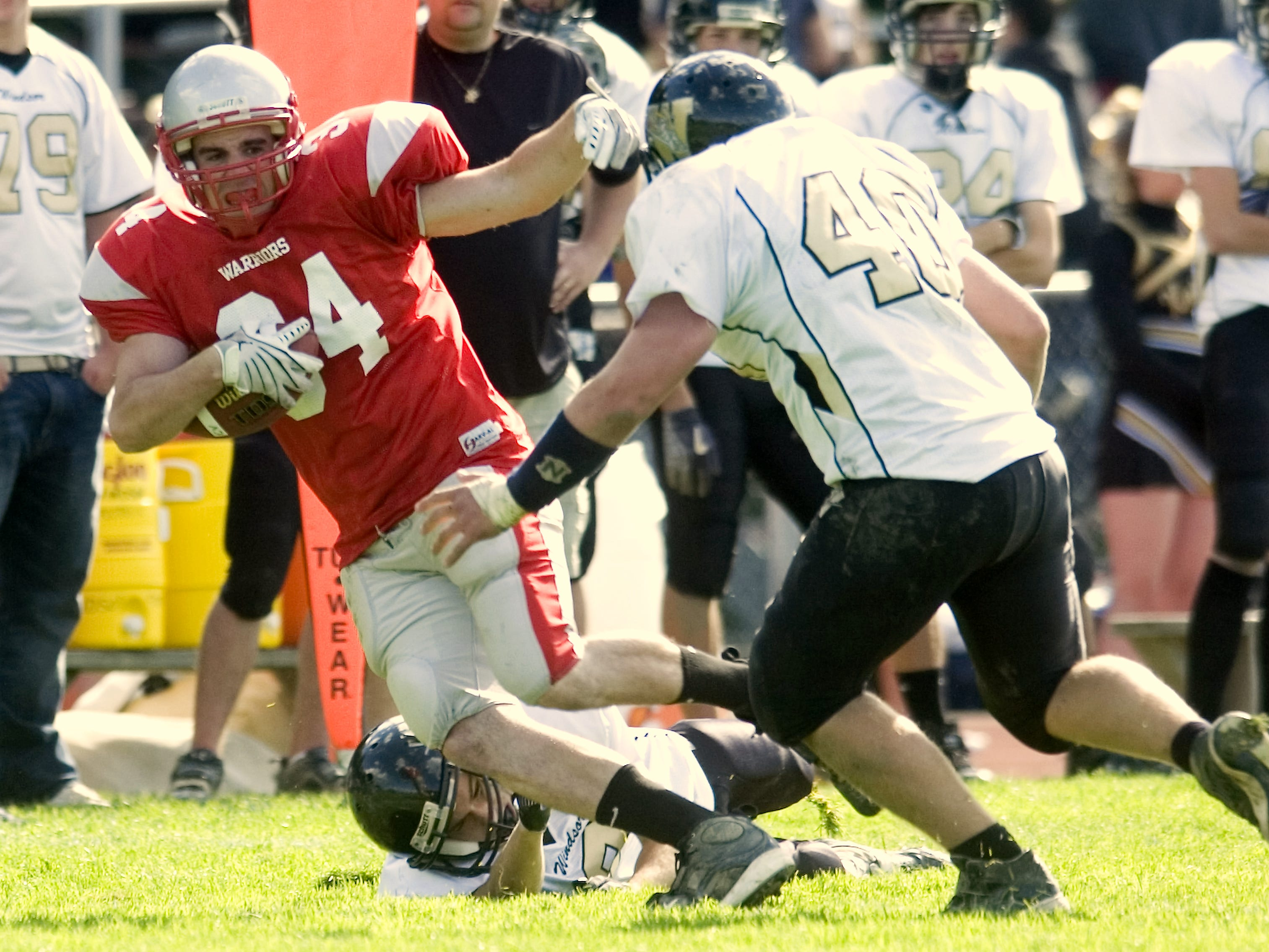From 2009: Chenango Valley's Tom Hull, left, looks to gets past Windsor's Noah Sibley, right, after eluding Danny Schreiber, bottom, in the third quarter of Saturday's game at CV.