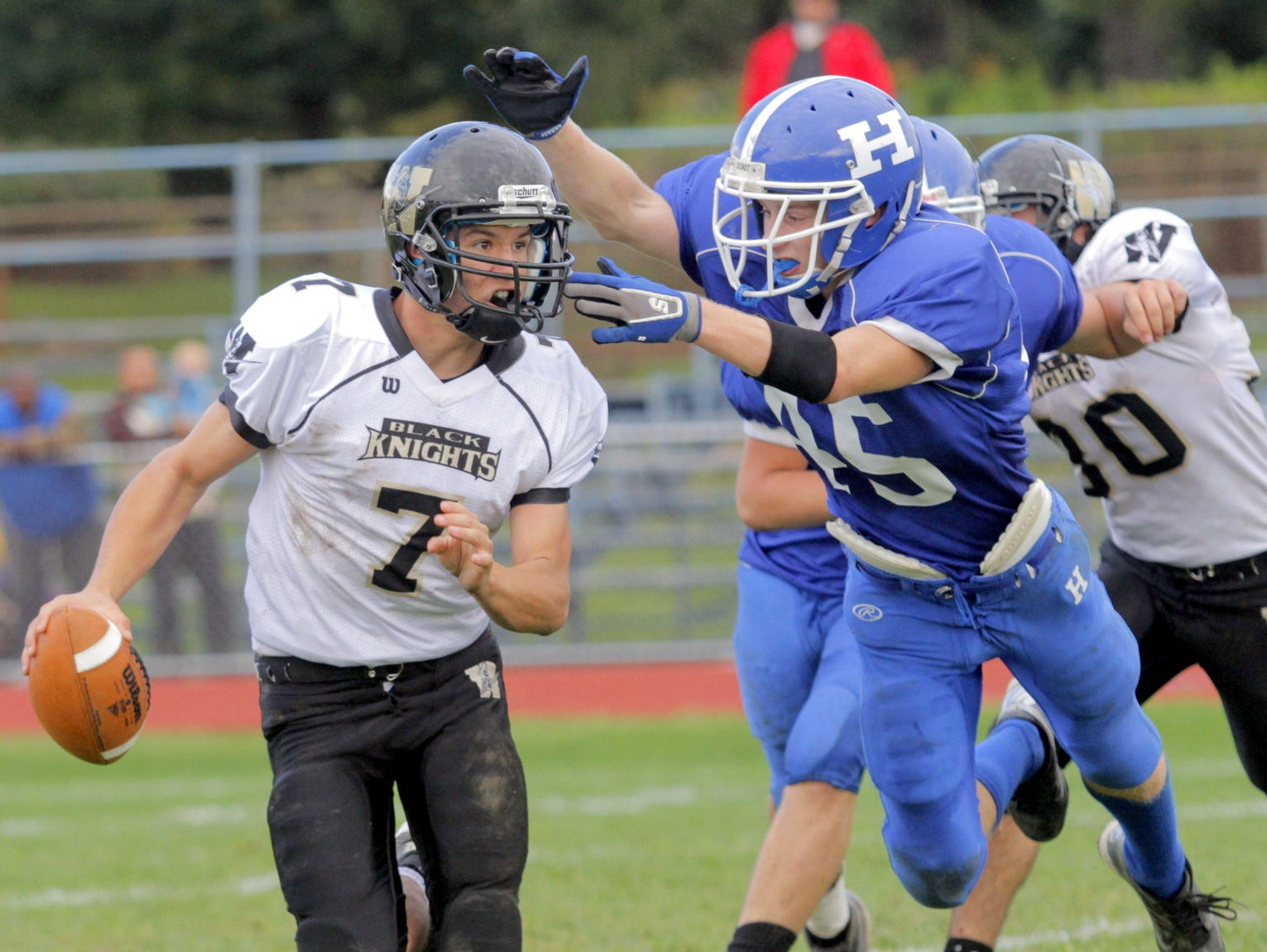 From 2012: Windsor quarterback Josh Cady tries to avoid a lunging Konnor Kremmer in the fourth quarter of Horseheads' 43-19 victory Saturday.