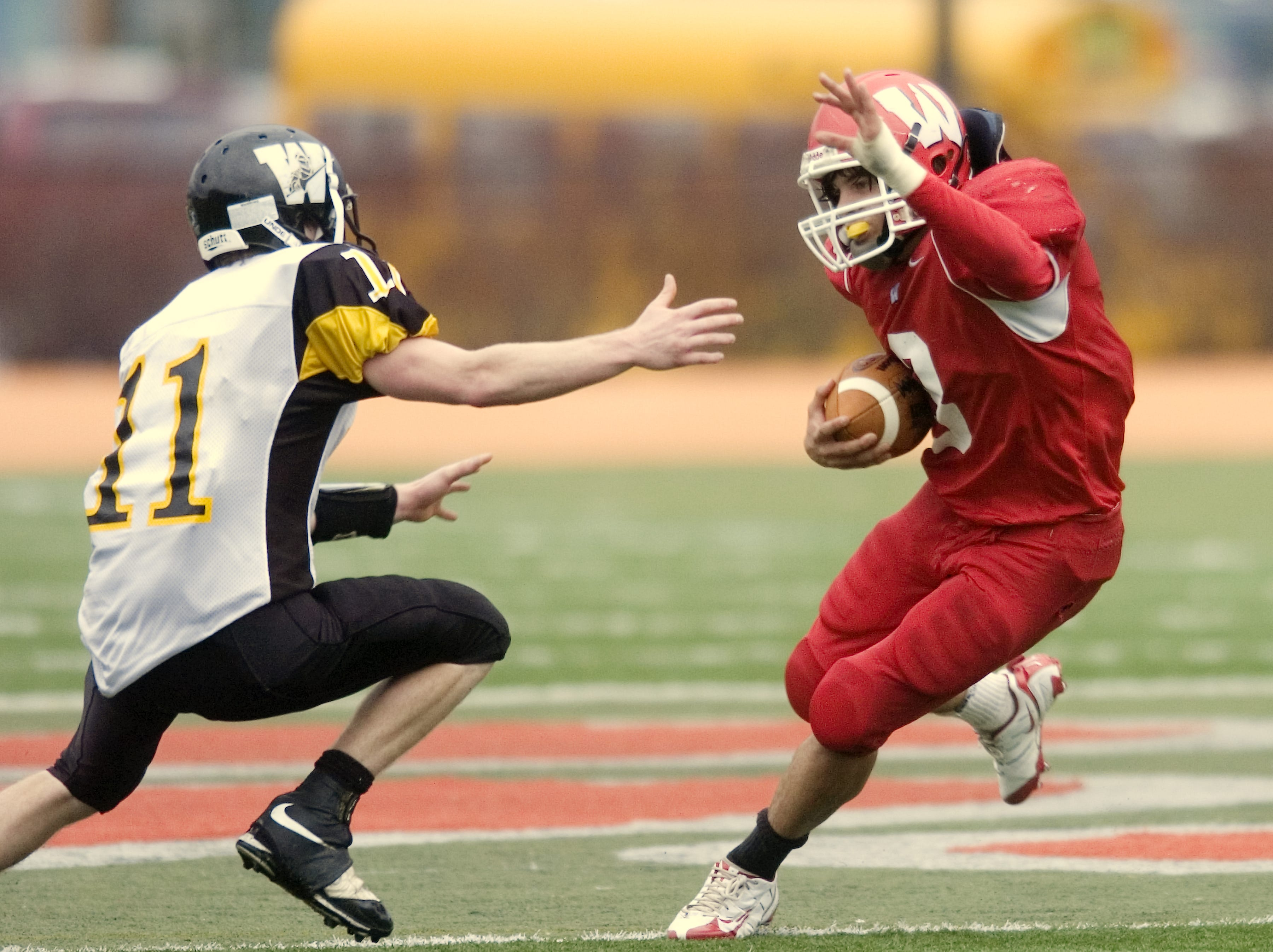 From 2008: Waverly's Brian Sewalt, right, dodges Windsor's Matt Murray in the fourth quarter of Saturday's game at Ty Cobb Stadium.