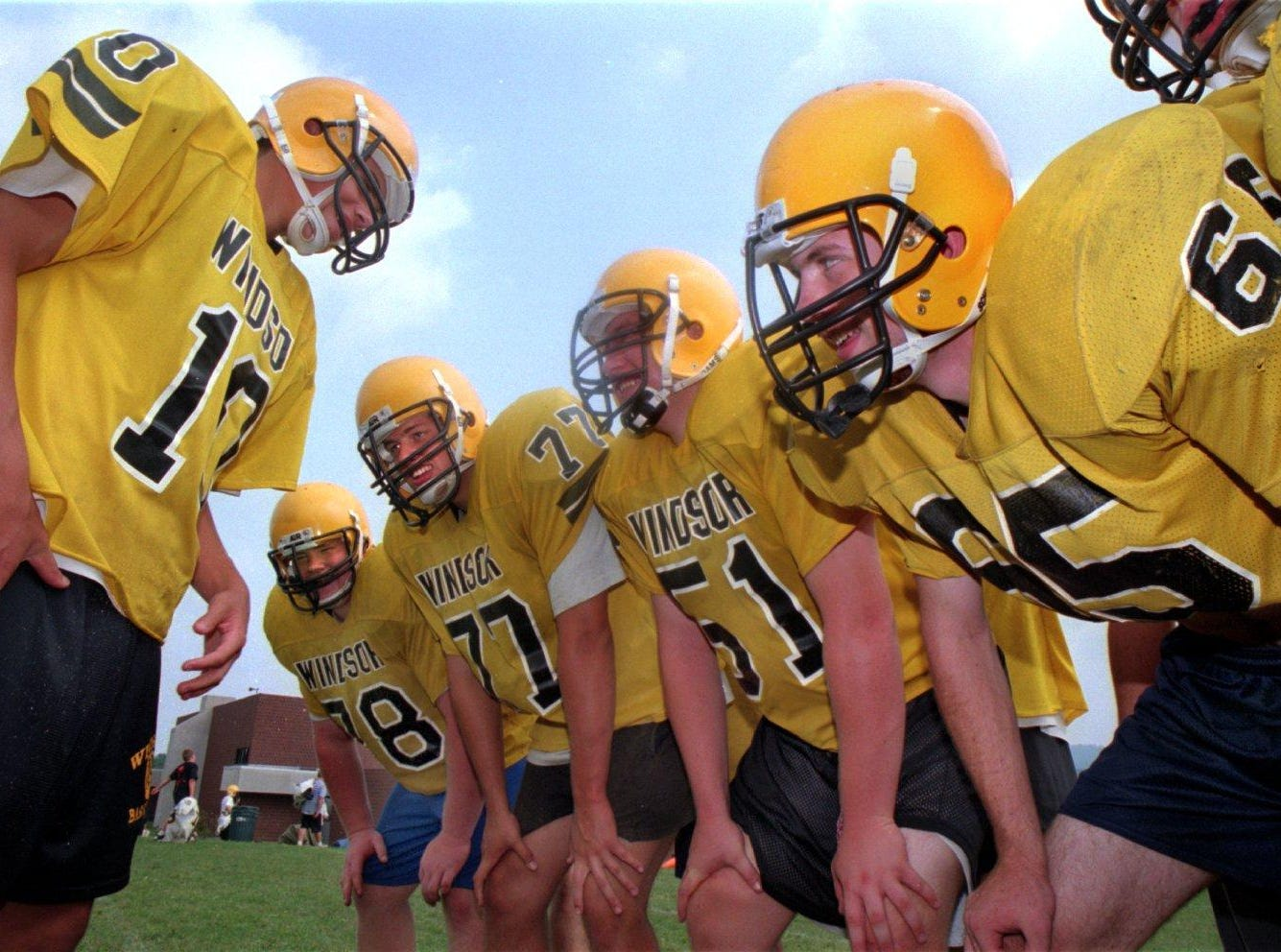 From 1996: Windsor High School Football players huddle up.