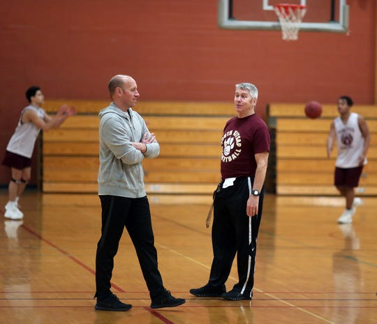South Kitsap basketball coaches Brian Cox (left) and  John Callaghan talk at practice during the 2018-19 season. Cox was hired this week to replace Callaghan as the Wolves' boys basketball coach.