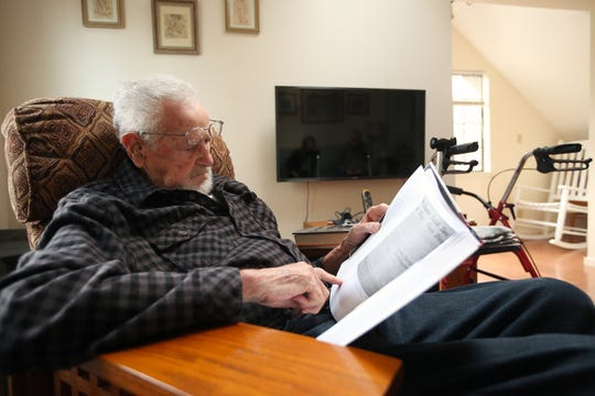 James Villiers, 95, looks for a quote to share in his Veterans Heritage Project book at his home in Suquamish.