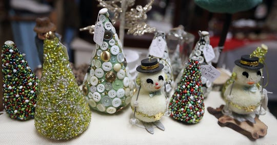 Festive tree and snowmen ornaments await buyers at Lemolo Vintage Market (aka the Christmas House) in North Kitsap.
