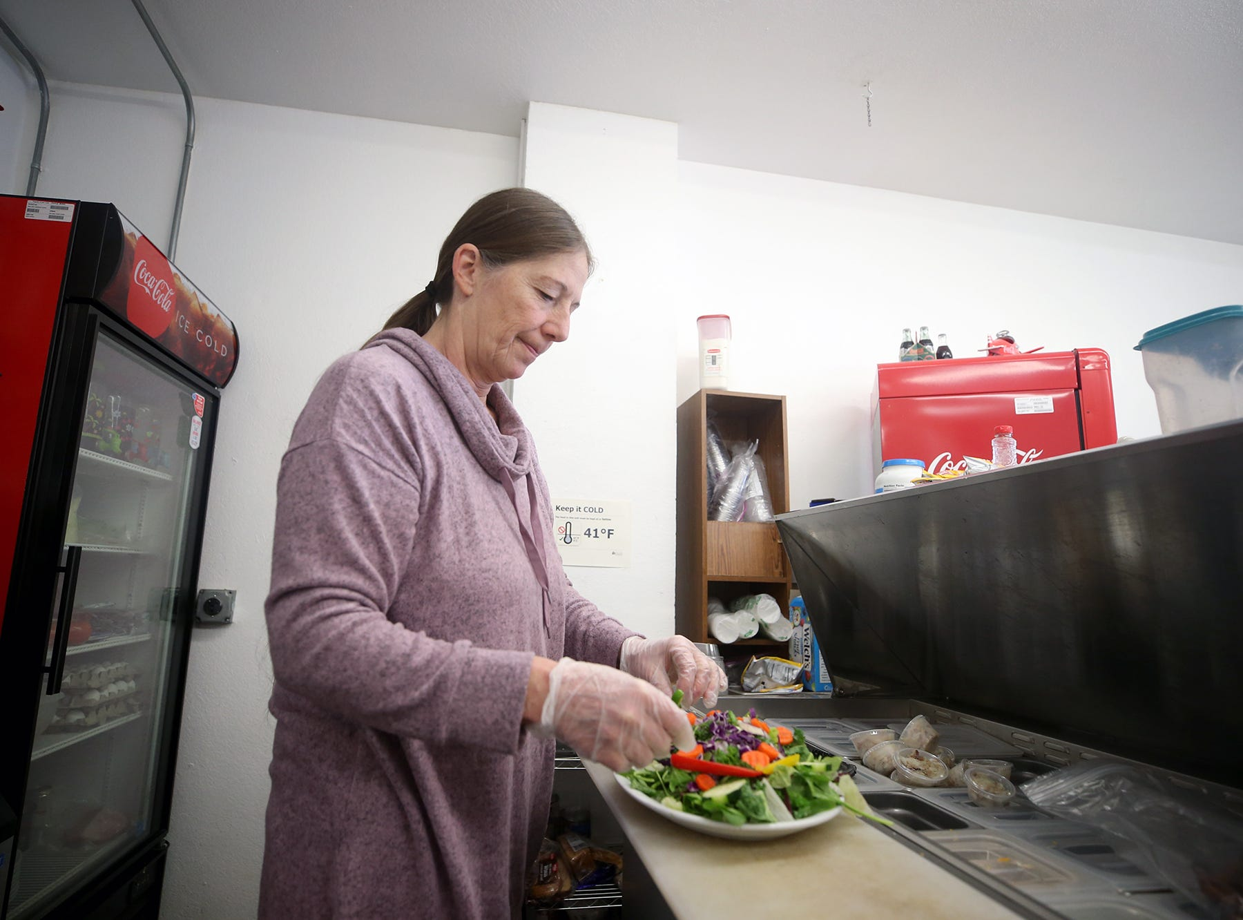 Lanette Duchesneau makes a crab salad with her special salad mix on Friday, November, 30, 2018. She is the owner of The Salad Shack in East Bremerton. The romaine lettuce scare has hurt her business.